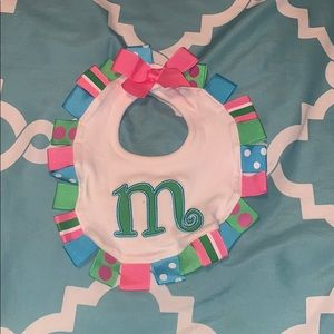 Baby girl bib with monogrammed M